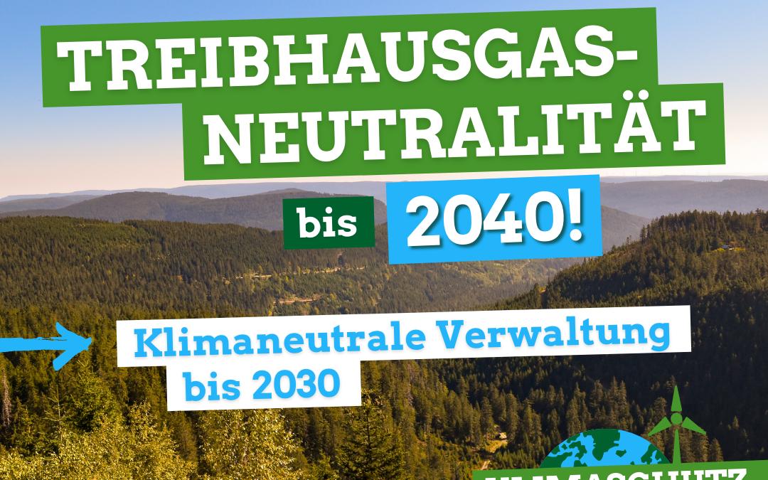 """Auf dem Bild ist ein wAld zu sehen und der titel """"treibhausgasneutralität bis 2040, klimaneutrale Verwaltung bis 2030"""